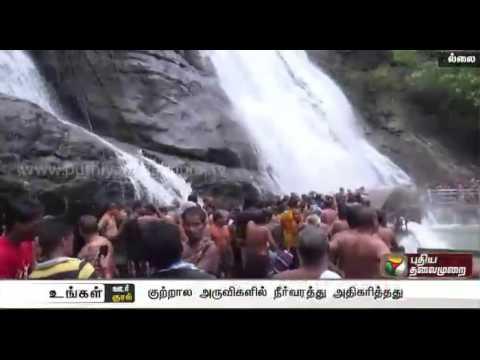 Rain increases water flow in Courtallam water falls