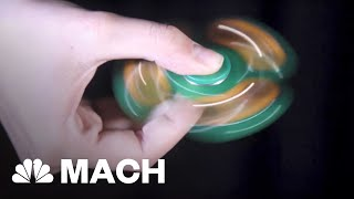 How Fidget Spinners Seem To Spin Forever | Mach | NBC News