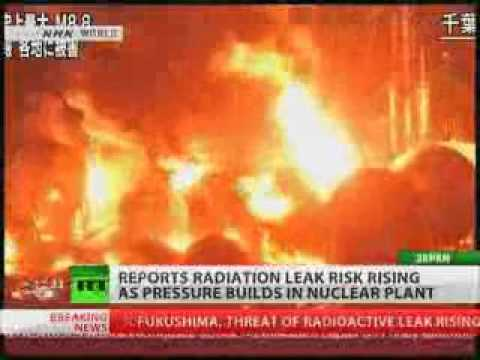 Burning oil refinery plant after earthquake in Japan