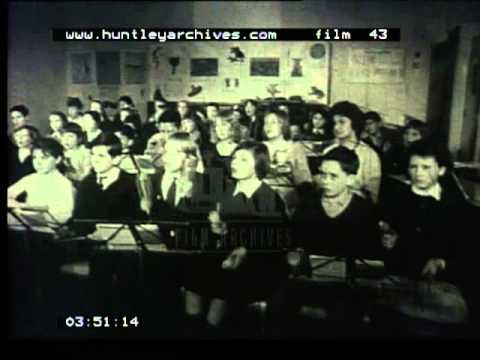 Music lessons given in school to children in the 1960's -- film 43