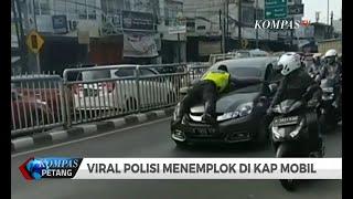 "Viral! Polisi ""Nemplok"" di Kap Mobil Berdamai dengan Pengemudi"