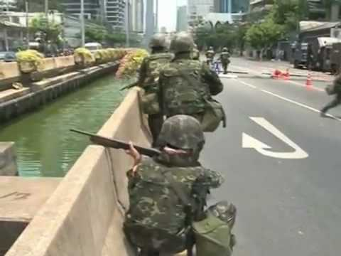 Video- Thai troops fire on redshirts in central Bangkok – World news – guardian.co.uk.mp4