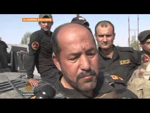 Iraqi army inches towards besieged oil plant