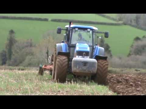 More New Holland TM 175 Tractor - Ploughing.