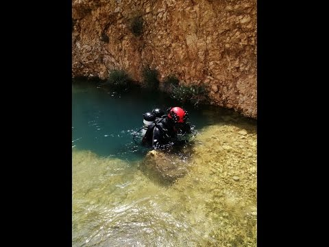 fighting strong water flow to enter a cave,,