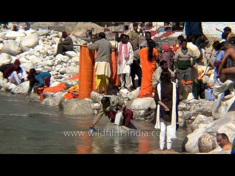 Devotees Bathing And Filling Bottles With Holy Water Of River Ganga In Gangotri video