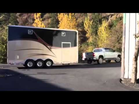 Tundra pulling double stacker trailer - YouTube
