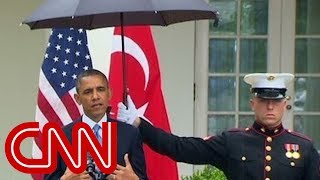 Obama asks Marines for umbrellas