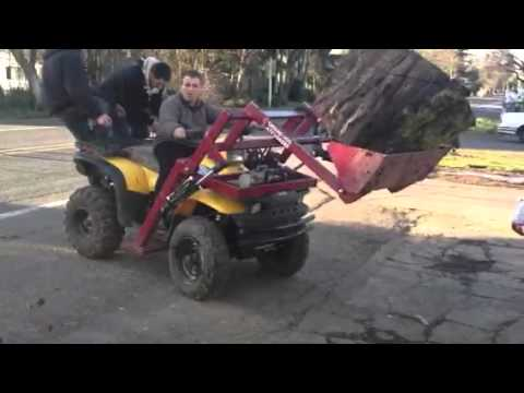 Ground hog atv front loader on polaris sportsman 500 lifting 700lb round of wet cherry