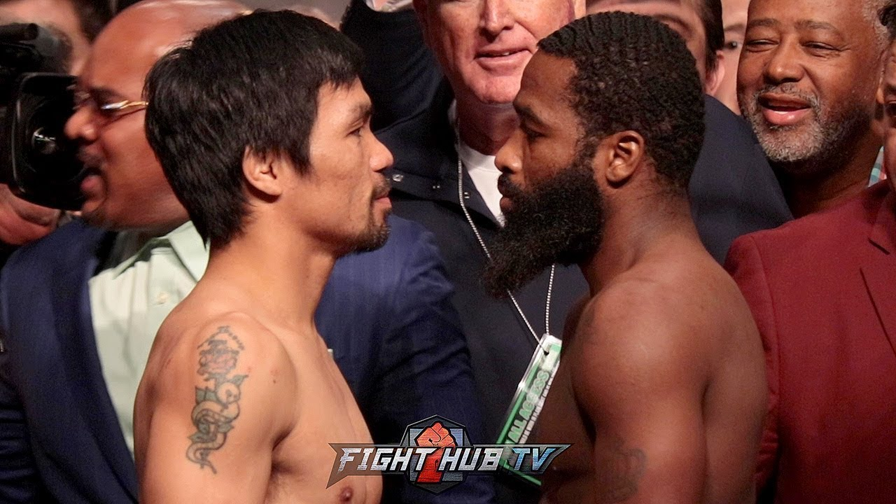 MANNY PACQUIAO AND ADRIEN BRONER FACE TO FACE IN TENSE WEIGH IN FACE OFF