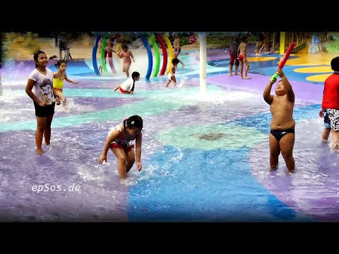 Beautiful Children Play on Wet Water Playground