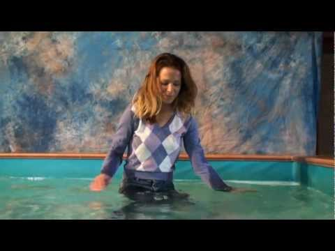 Cleo in purple pullover in the pool