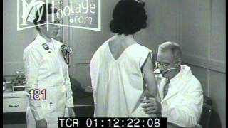 Stock Footage - 1940's DOCTOR'S OFFICE EXAMINATION OF PATIENTS,XRAY