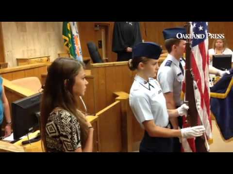 Kayla Sanders, 9th grader from our Lady of the Lakes, Waterford, sings anthem at Oakland Co. regiona