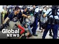 Hong Kong police face off with protesters as airport protests...