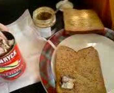 Making of a pilchard and mustard sandwich