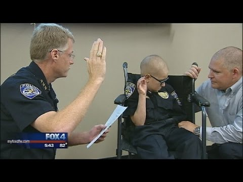Boy with cancer sworn in as honorary Frisco Police officer