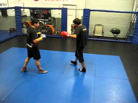 Nicolas Saignac teaching savate combos with Eric Brown at CSW training center. Image 1