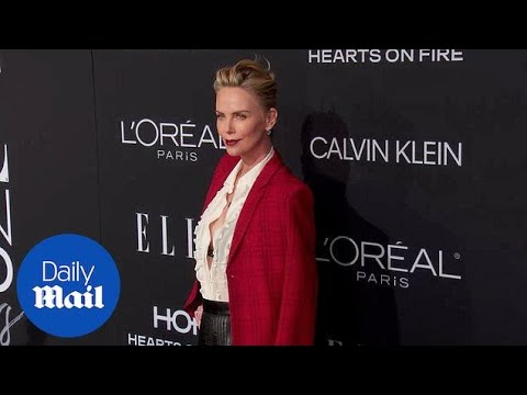 Charlize Theron is red hot at Elle Women in Hollywood