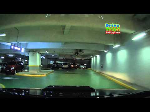 Driving inside SM Aura's carpark. The SM Aura's carpark was nice. Up to many basements (lost count maybe three). Sorry got confused with the signs of the wro...