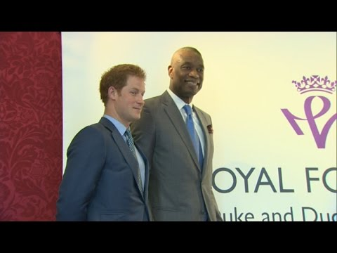 Basketball star Carmelo Anthony gives Prince Harry signed boot and shirt