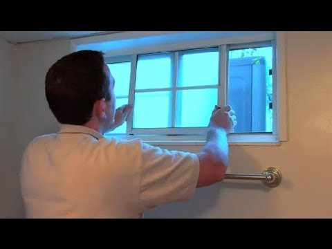 How to Repair a Vinyl Sliding Window That Is Off It's Track Pivot : Window Cleaning