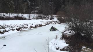 Snowmobile on frozen lake
