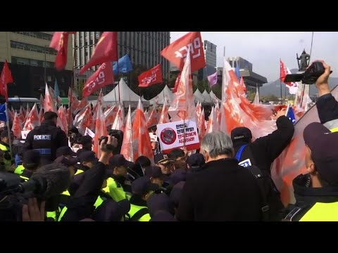 Raw: Protests in Seoul During Trump Visit