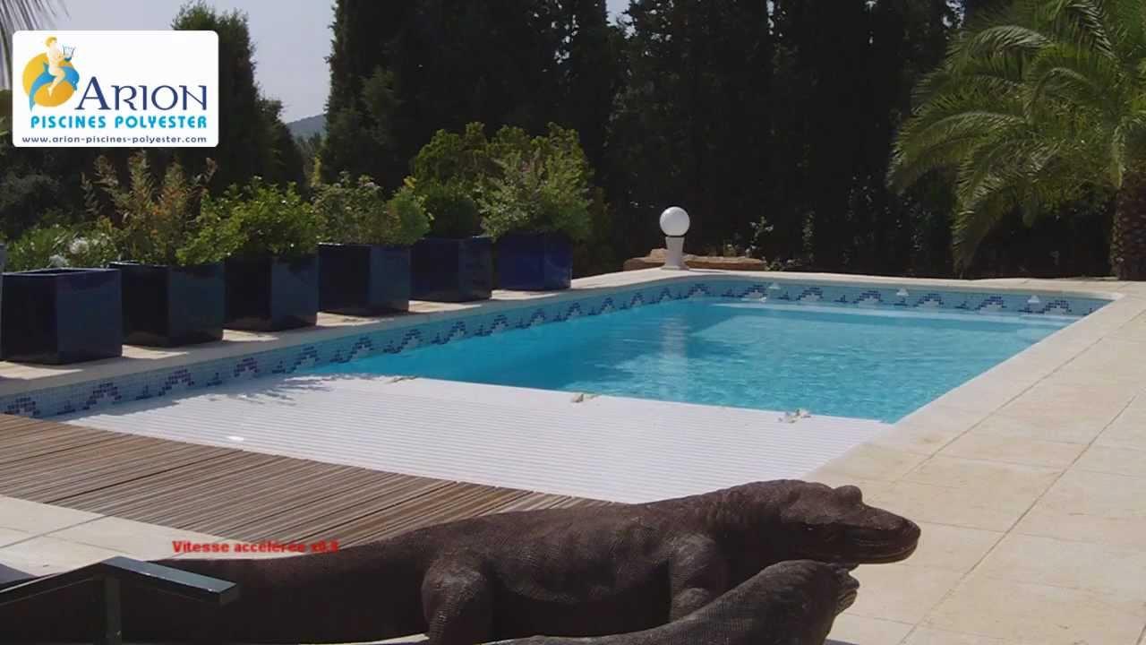 Volet roulant piscine principe for Piscine miroir et volet roulant