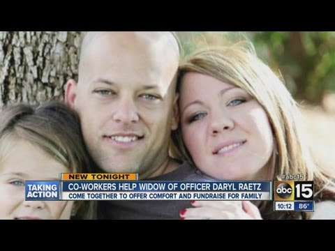 Co-workers help widow of fallen police officer
