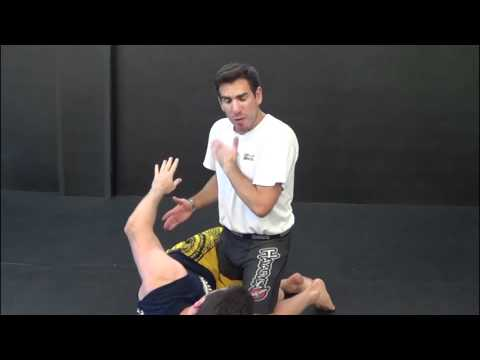 MMA techniques: Half-guard one-arm guillotine by Kenny Florian Image 1