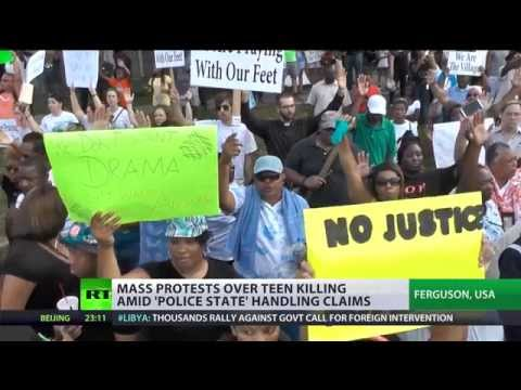 'Hands Up! Don't Shoot!' Ferguson protesters take to streets for sixth day