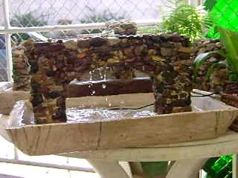 Fuente de agua de piedras y base de cemento youtube for Como hacer una fuente de agua para jardin