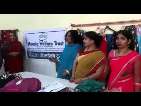 Mrs.Noorjehan Ayub Khan Donating clothes stitching machine