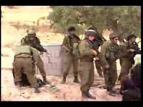 Israeli soldiers greeting Palestinian women