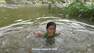 Primitive Survival Skills - Catching Two Catfish at The River and Cooking Fish - Eating Delicious