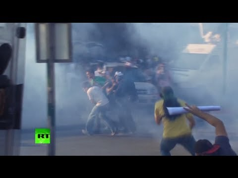 Video: Cops teargas Brazilians angered by sporting events spending