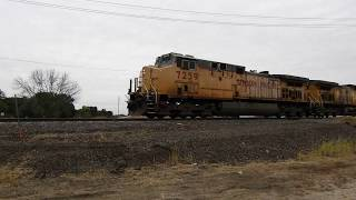 UP 7259 and UP 6254 lead a frac sand train east through Rochelle IL
