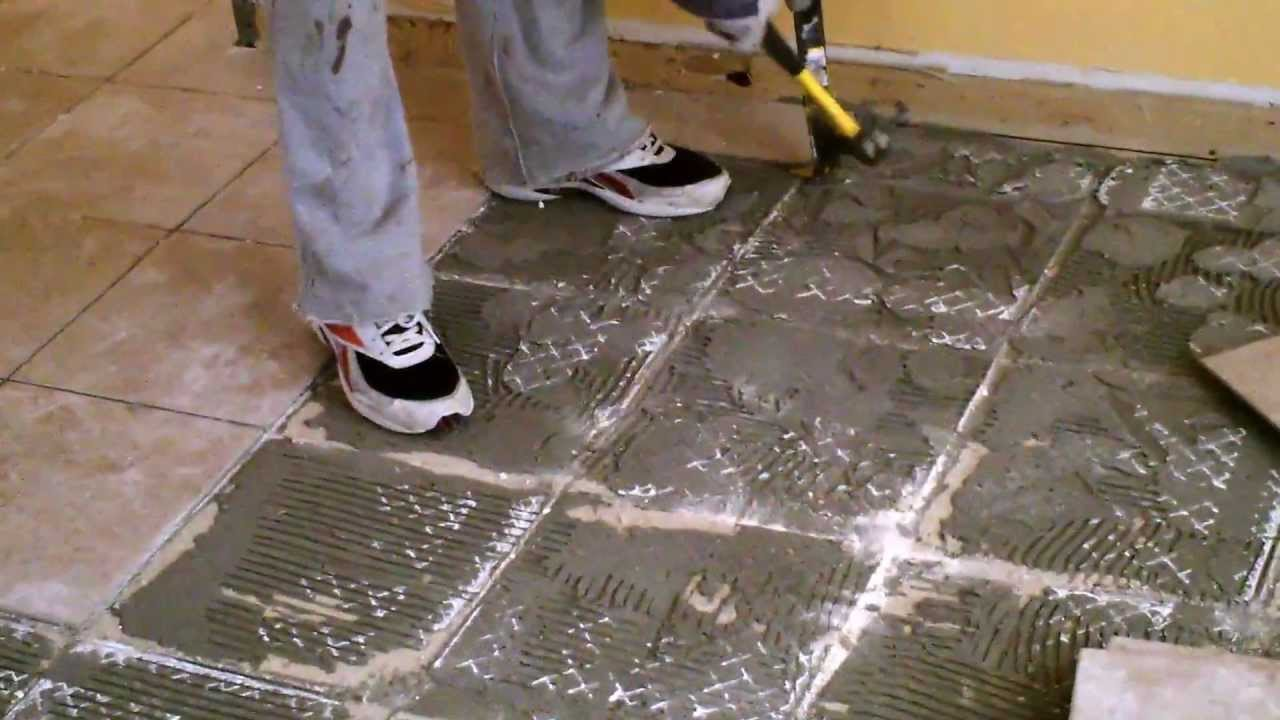 Remove ceramic floor tiles