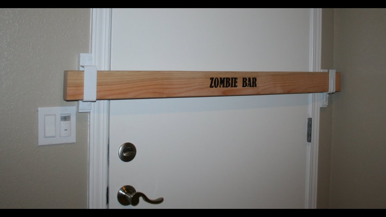 Zombie bar security door barricade youtube for Front door security bar