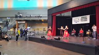 Curvy spandex wearing dancers doing the Pervuvian Mambo.