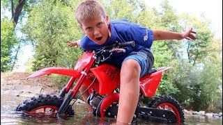 Funny Baby STUCK in the RIVER Kid Ride on New Dirt Cross Bike Towing Power Wheel