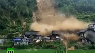 Terrible scenes as mountain torrents crash down houses in China