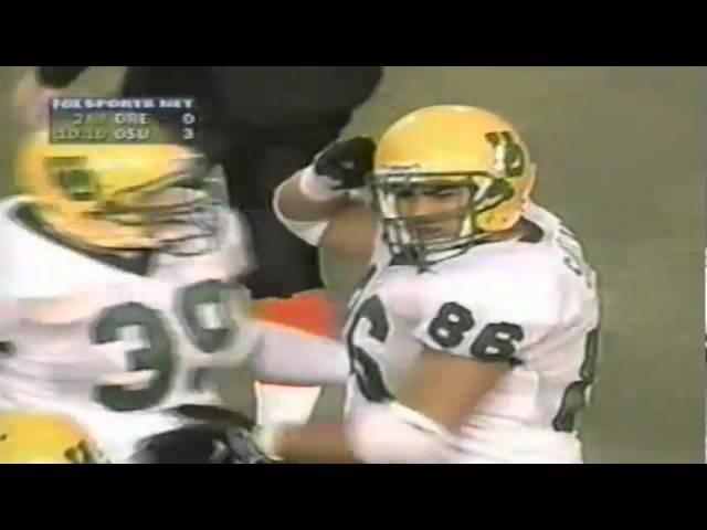 Oregon DT Leie Sualua upends OSU RB Ken Simonton for no gain 11-21-98