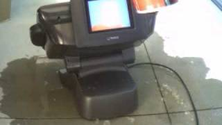 Pouring Coke on a Touchscreen Point of Sale Terminal