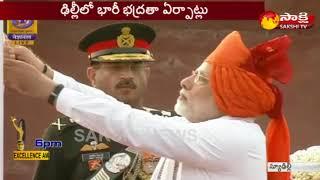 PM Modi  Flag Hoisting ceremony and address to the Nation -- ఎర్రకోటపై జెండా ఆవిష్కరించిన ప్రధాని - netivaarthalu.com