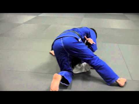 Christian Uflacker teaches how to attack shoulder lock from side control