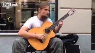 Amazing guitarist---holy crap! fingers on fire!!