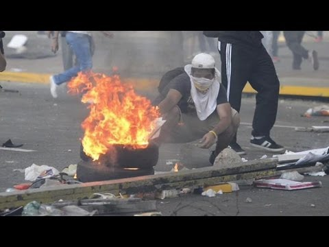 Protesters clash with riot police in Venezuela