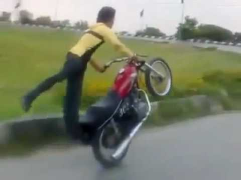 Pakistani Boy Bike Stunts One Wheeling.mp4.flv